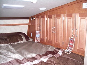Cabinetry next to bed